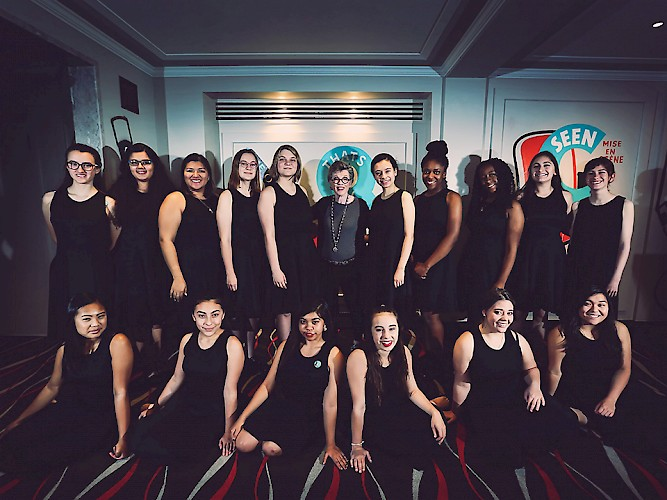 Carole Shorenstein Hays poses with one of the performance groups from Sacred Heart Prep.