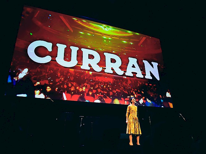 Carmen Cusack on stage at A Curran Occasion