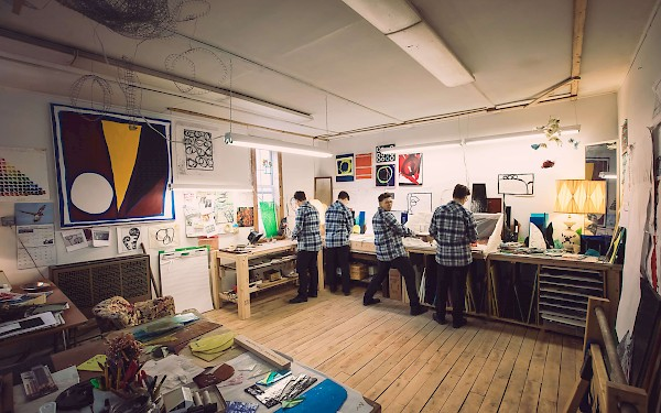 Artist Holly Rae Taylor shows off her workshop and art and strikes a pose in her Vermont studio. (c) Little Fang Photography